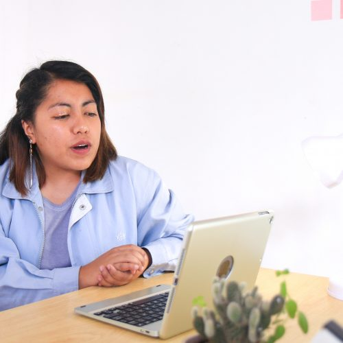 woman using a laptop for online consultation for pain solutions